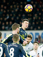 Football - 2016 / 2017 Premier League - Swansea City vs. Arsenal<br /> <br /> Olivier Giroud of Arsenal heads the ball , at the Liberty Stadium.<br /> <br /> COLORSPORT/WINSTON BYNORTH