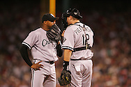 BOSTON - OCTOBER 7:  Orlando Hernandez of the Chicago White Sox talks things over with A.J. Pierzynski during Game 3 of the American League Divisional Series against the Boston Red Sox at Fenway Park on October 7, 2005 in Boston, Massachusetts.   The White Sox defeated the Red Sox 5-3 to sweep the Red Sox and advance to the American League Championship Series.