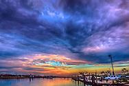 The sun sets at the Bayou La Batre State Docks in Bayou La Batre, Alabama. (Photo by Carmen K. Sisson/Cloudybright)
