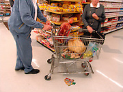 Elderly couple buying groceries.