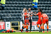 Notts County forward Shola Ameobi (9) and Wycombe Wanderers defender Adam El-Abd (6) have a disagreement over the challenge from Ameobi during the EFL Sky Bet League 2 match between Notts County and Wycombe Wanderers at Meadow Lane, Nottingham, England on 30 March 2018. Picture by Simon Davies.