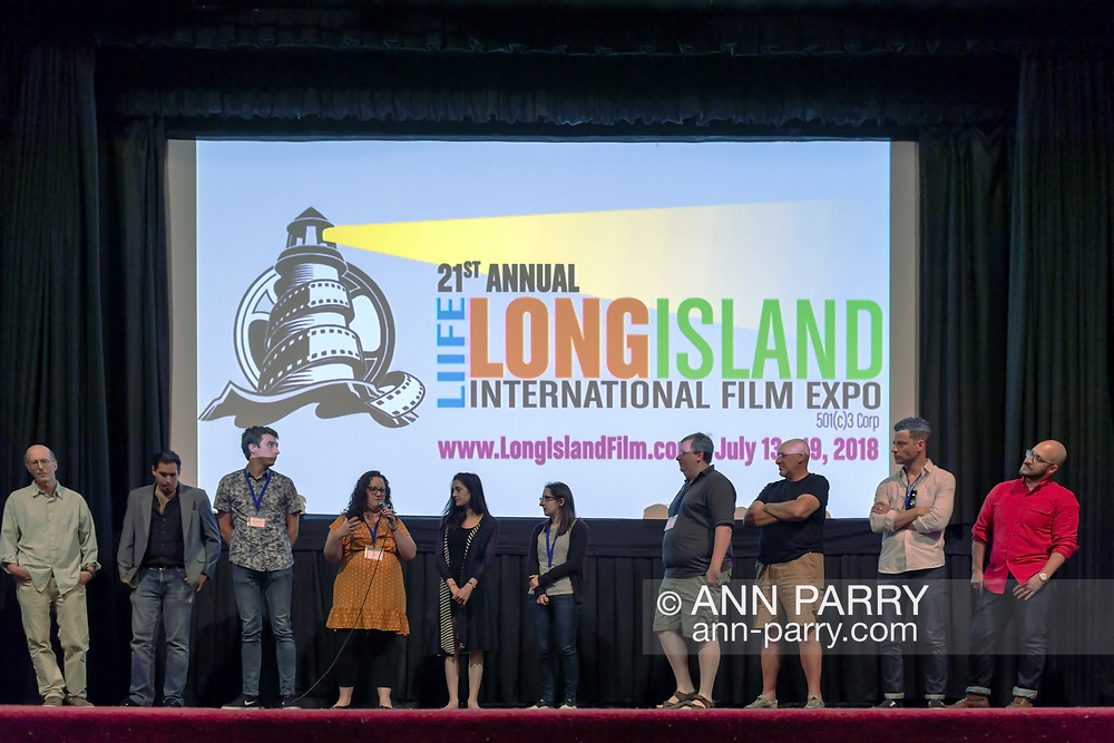 Bellmore, New York, USA. July 18, 2018. After final block of film screenings at LIIFE 2018, the Long Island International Film Expo, filmmakers and actors go on stage for Q&A at Bellmore Movies. SHARA ASHLEY ZEIGER, speaking into mic, is producer and writer of romcom short film JOE; right of her are AJNA JAI, who plays title character in The Adventures of Penny Patterson; and STEPHANIE DONNELLY, writer and director of that film.