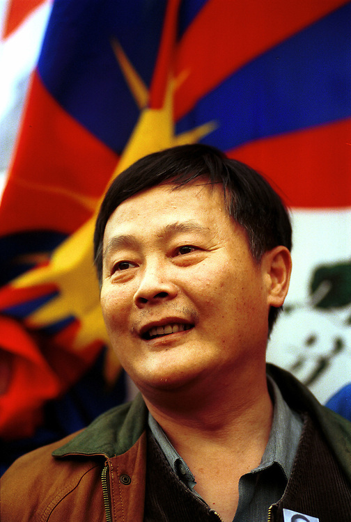 The Chinese dissident Wei Jingsheng during a demonstration protesting the visit to France of Chinese president Jiang Zemin at the Place de la Bastille..Paris, 24 October 1999..Photo © J.B. Russell