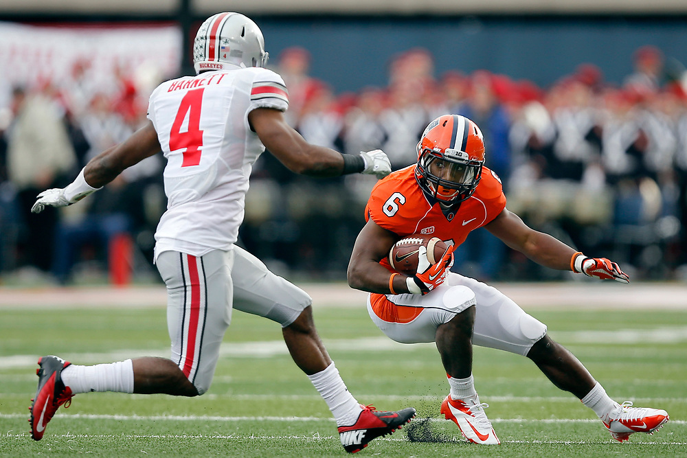 Illinois running back Josh Ferguson (6) looks for room to run against Ohio State safety C.J. Barnett (4) during the first half of an NCAA college football game at Memorial Stadium Saturday, Nov. 16, 2013 on the University of Illinois campus in Champaign, Ill. (Lee News Service/ Stephen Haas)