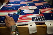 Inside the Mountainair Senior Center, friends chat while working on a American flag themed quilt.