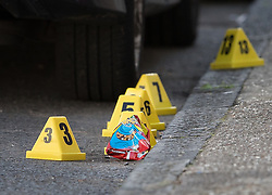 © Licensed to London News Pictures. 30/09/2017. London, UK. Police evidence markers are seen in the road after a man was fatally stabbed in Bow, East London. Police were called at 2:30 am on Saturday, 30 September to reports of a disturbance in E3. Officers found a 21-year-old man suffering from stab injuries. He was treated at the scene by London's Air Ambulance before being taken to an east London hospital where he died. Detectives from the Homicide and Major Crime Command are investigating. Photo credit: Peter Macdiarmid/LNP