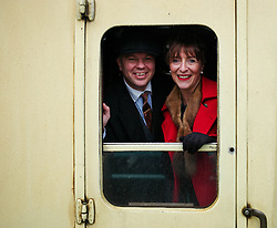 © Licensed to London News Pictures. <br /> 16/10/2016. <br /> Grosmont, UK.  <br /> <br /> A couple in 1940's period clothing pose for a photograph from the window of their train carriage door at Grosmont station during the final day of the North Yorkshire Moors Railway Wartime Weekend event. <br /> The annual event brings together re-enactors and enthusiasts along the length of the NYMR heritage steam railway line to recreate the feel of the war years of the 1940's. <br /> <br /> Photo credit: Ian Forsyth/LNP