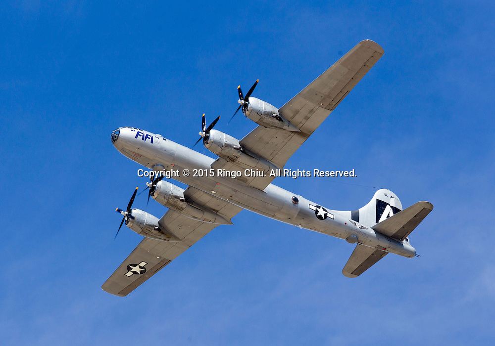 """""""FIFI"""" the world's only flying B-29 Super-fortress performs during Los Angeles County Air Show, in Lancaster, California on March 21, 2015. (Photo by Ringo Chiu/PHOTOFORMULA.com)"""