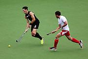 Simon Child of New Zealand in action. Glasgow 2014 Commonwealth Games. Hockey, Black Sticks Men v England, Glasgow Green Hockey Centre, Glasgow, Scotland. Tuesday 29 July 2014. Photo: Anthony Au-Yeung / photosport.co.nz