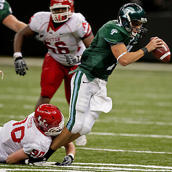 Oct 17, 2009; New Orleans, LA, USA;  Tulane Green Wave quarterback Joe Kemp (7) is sacked by Houston Cougars defensive lineman Zeke Riser (90) during the second half at the Louisiana Superdome. Houston defeated Tulane 44-16. Mandatory Credit: Derick E. Hingle-US PRESSWIRE