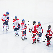 Players after the Frozen Fenway game between The Northeastern Huskies and The UMass Lowell Riverhawks at Fenway Park on January 11, 2014 in Boston, Massachusetts.