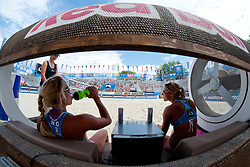 Erika and Simona Fabjan of Slovenia on bench at A1 Beach Volleyball Grand Slam tournament of Swatch FIVB World Tour 2010, on July 27, 2010 in Klagenfurt, Austria. (Photo by Matic Klansek Velej / Sportida)