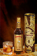 Tortuga rum advertisement, bottle, glass of rum and packaging