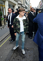 Romeo Beckham leaves after attending the Victoria Beckham London Fashion Week SS19 show in Dover Street, London.