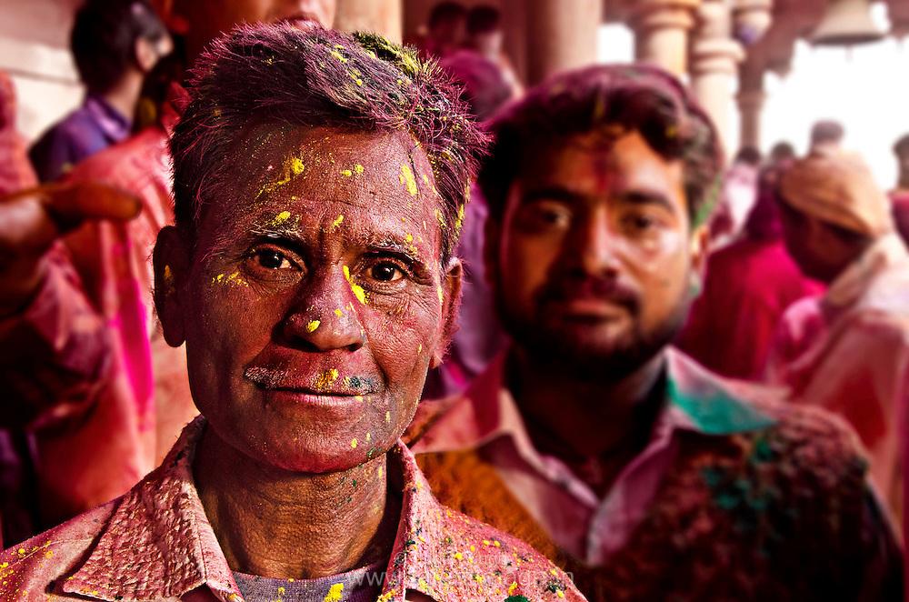 Local resident during the celebration at Radha Rani Temple. Braj ki Holi