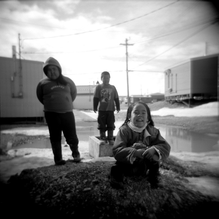 Lisa, age 7 (front), plays outside with two friends in the constant summer light in the Inuit town of Resolute Bay, located in the far North of Canada, on Tuessday, June 12, 2007. ..... **GERMANY OUT**