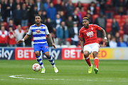 Nottingham Forest forward Britt Assombalonga (9) passes the ball during the EFL Sky Bet Championship match between Nottingham Forest and Reading at the City Ground, Nottingham, England on 22 April 2017. Photo by Jon Hobley.
