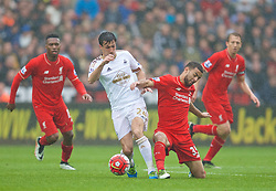 SWANSEA, WALES - Sunday, May 1, 2016: Liverpool's Kevin Stewart in action against Swansea City's Jack Cork during the Premier League match at the Liberty Stadium. (Pic by David Rawcliffe/Propaganda)