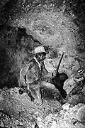 A miner searches for silver at the silver mines in Potosi, Bolivia.