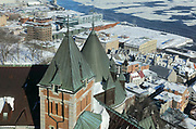 View towards the Saint Lawrence river from the Fairmont Gold Lounge on the 14th floor of the Chateau Frontenac, opened 1893, designed by Bruce Price as a chateau style hotel for the Canadian Pacific Railway company or CPR, in Quebec City, Quebec, Canada. The building was extended and the central tower added in 1924, by William Sutherland Maxwell. The building is now a hotel, the Fairmont Le Chateau Frontenac, and is listed as a National Historic Site of Canada. The Historic District of Old Quebec is listed as a UNESCO World Heritage Site. Picture by Manuel Cohen