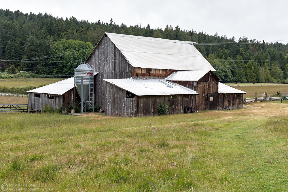 Heritage Barn (built around 1900) near the original farmhouse on the Ruckle Farm.  Photographed at Ruckle Provincial Park on Salt Spring Island, British Columbia, Canada