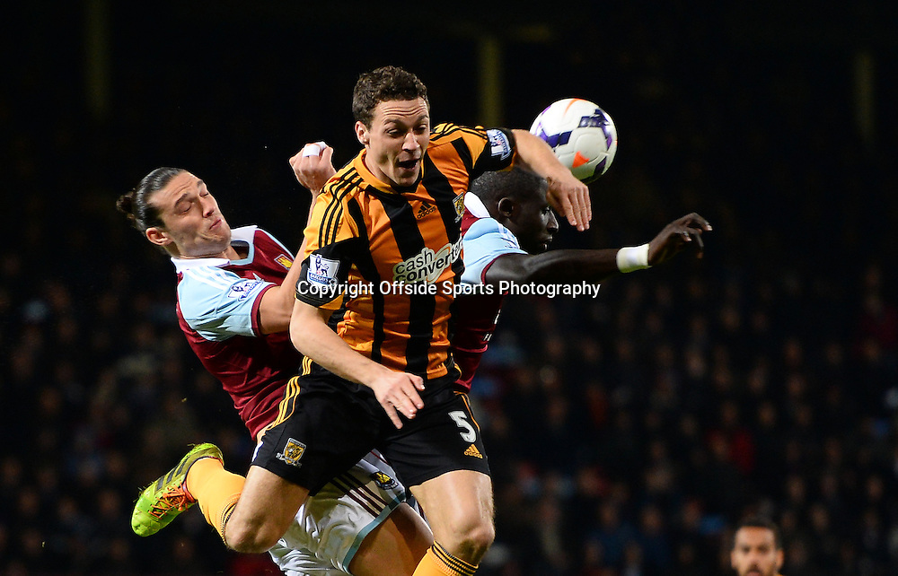 26 March 2014 - Barclays Premier League - West Ham United v Hull City - Andy Carroll of West Ham United in action with James Chester of Hull City - Photo: Marc Atkins / Offside.