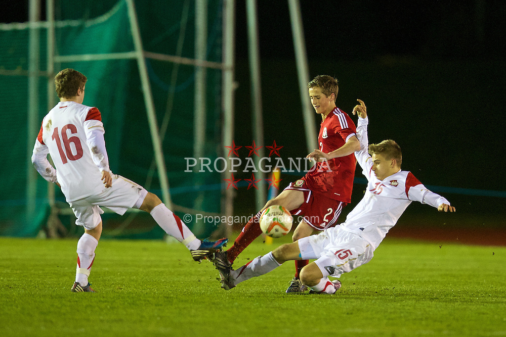 CONNAH'S QUAY, WALES - Thursday, March 20, 2014: Wales' Joe Lewis in action against Poland's Lukasz Adamczak and Marek Mroz during the Under-15's International Friendly match at the Deeside Stadium. (Pic by David Rawcliffe/Propaganda)