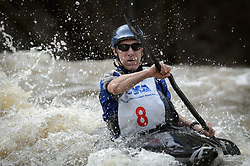 Vince Swoboda of St. Louis, Mo. races in the K1 Men's Expert class on the slalom course of the 45th Annual Missouri Whitewater Championships. Swoboda placed ninth in the class, and first in the downriver K-1 Wildwater class. The Missouri Whitewater Championships, held on the St. Francis River at the Millstream Gardens Conservation Area, is the oldest regional whitewater slalom race in the United States. Heavy rain in the days prior to the competition sent water levels on the St. Francis River to some of the highest heights that the race has ever been run. Only expert classes were run on the flood level race course.