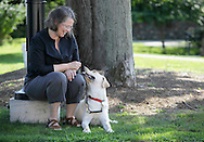 Cheryl Devine of Warwick sits with Hamilton before saying goodbye to him after he was tested at Guiding Eyes for the Blind in Yorktown Heights on Aug. 25, 2009.