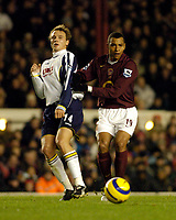 Photo: Leigh Quinnell.<br /> Arsenal v Portsmouth. The Barclays Premiership.<br /> 28/12/2005. Portsmouths Matthew Taylor is pushed to one side by Arsenals Gilberto.