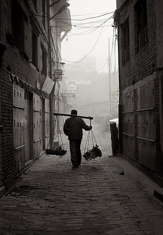 Street vendor walking in Patan, Nepal. <br /> Photo by Lorenz Berna
