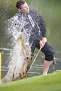 June 05 2009; Newport Wales. Branden GRACE (RSA) plays a shot from the lake on the 3rd hole while competing in the second round of the European Tour Welsh Open golf tournament. Mandatory credit: Mitch Gunn-Sportsphotographers.eu