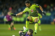 Danny Williams (Reading) hurdles Keiren Westwood (Sheffield Wednesday) as the keeper makes a save during the EFL Sky Bet Championship match between Sheffield Wednesday and Reading at Hillsborough, Sheffield, England on 17 March 2017. Photo by Mark P Doherty.