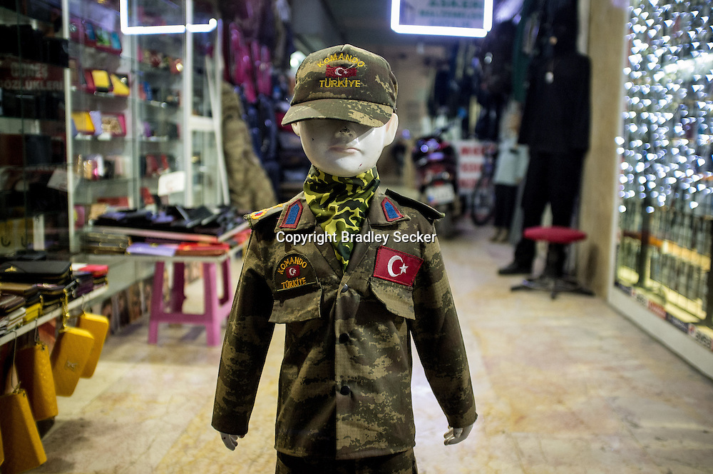 ANTAKYA, TURKEY. JANUARY 23. A child mannequin dressed as a Turkish soldier, advertises a military supply store in downtown Antakya, where many Syrians come to buy clothing and basic equipment. Bradley Secker for the Washington Post