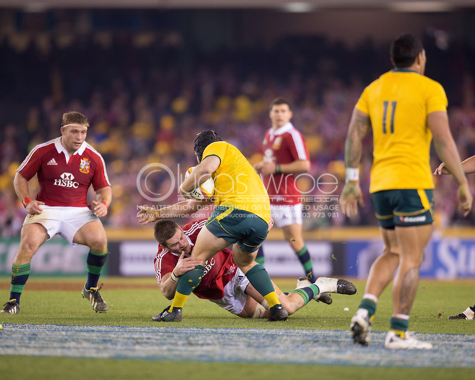 Benn Robinson (Wallabies) is tackled by Dan Lydiate (Lions) during the second test between the DHL Australian Wallabies vs HSBC British And Irish Lions at Etihad Stadium, Melbourne, Victoria, Australia. 29/06/0213. Photo By Lucas Wroe