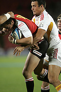 JOHANNESBURG, SOUTH AFRICA - 23 April 2011: Doppies la Grange of the Lions is tackled by Richard Kahui during the Super Rugby Match between the MTN Lions and the Chiefs held at Coca Cola Park Stadium, Johannesburg, South Africa. Photo by Dominic Barnardt