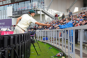 Pat Cummins of Australia hand back a young fans frograme after signing it during the International Test Match 2019, fourth test, day three match between England and Australia at Old Trafford, Manchester, England on 6 September 2019.