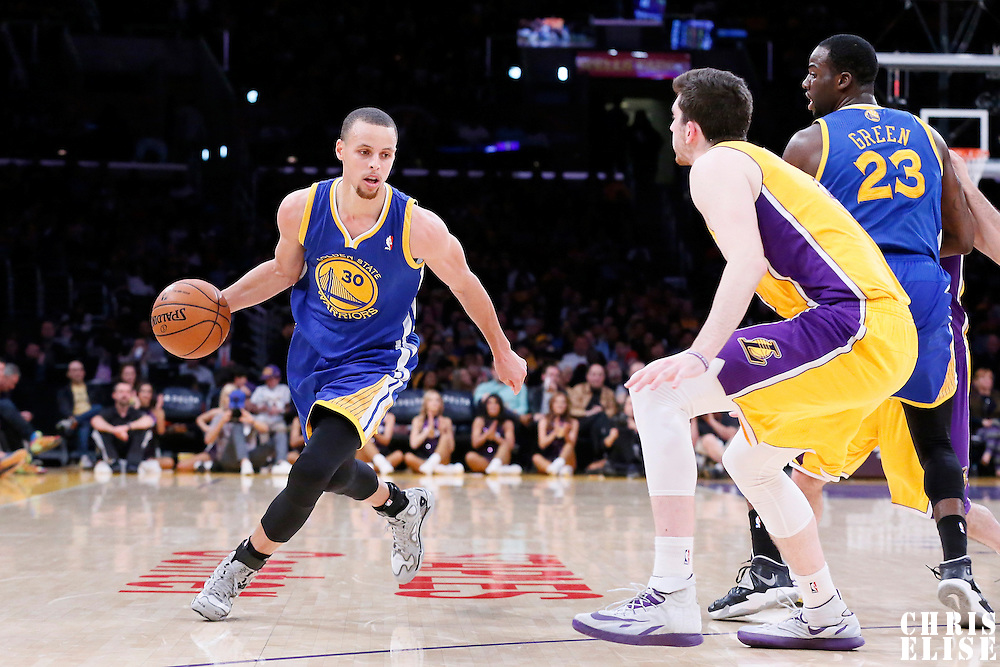 11 April 2014: Golden State Warriors guard Stephen Curry (30) drives past Los Angeles Lakers forward Ryan Kelly (4) during the Golden State Warriors 112-95 victory over the Los Angeles Lakers at the Staples Center, Los Angeles, California, USA.