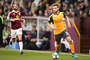 Arsenal defender Shkodran Mustafi (20)  covers well  during the Premier League match between Burnley and Arsenal at Turf Moor, Burnley, England on 2 October 2016. Photo by Simon Davies.