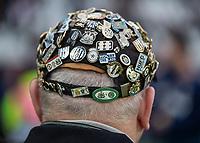 Football - 2018 / 2019 Premier League - West Ham United vs. Newcastle United<br /> <br /> Newcastle United fan with his cap covered in badges at the London Stadium<br /> <br /> COLORSPORT/DANIEL BEARHAM