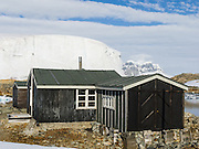 "In the Argentine Islands, Antarctica, Wordie House (1947-1954) has been restored and is designated under the Antarctic Treaty System as Historic Site and Monument No. 62. The United Kingdom first established meteorological research here as Base F or ""Argentine Islands"" on Winter Island in 1947. The main hut, built on the site of an earlier British Graham Land Expedition hut, was named after Sir James Wordie, a member of Shackleton's Imperial Trans-Antarctic Expedition who visited during its construction. The original main hut, ""Wordie House,"" now comprises the kitchen and bunk room. The base was extended in 1951 to include a generator shed, office, store, and toilet. A larger hut was built on nearby Galindez Island in 1954 and renamed Faraday Station in 1977. Researchers at Faraday Station shocked the scientific community by discovering the Antarctic ""ozone hole"" in 1985. Operational transfer to Ukraine in 1996 renamed Faraday Station to Vernadsky Research Base (Akademik Vernadsky)."