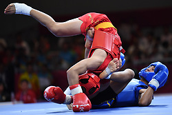 JAKARTA, Aug. 19, 2018  Kan Kai Wa (Top) of China's Macao competes with Jason Goh of Singapore during Men's Sanda-56kg Round of 32 in the 18th Asian Games in Jakarta, Indonesia, Aug. 19, 2018. Kan Kai Wa won 2-0. (Credit Image: © Pan Yulong/Xinhua via ZUMA Wire)