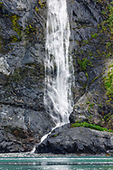 Waterfall in Surprise Inlet in Prince William Sound in Southcentral Alaska. Summer. Afternoon.