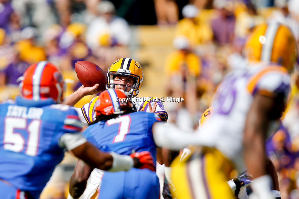 Oct 12, 2013; Baton Rouge, LA, USA; LSU Tigers quarterback Zach Mettenberger (8) throws against the Florida Gators during the first quarter of a game at Tiger Stadium. Mandatory Credit: Derick E. Hingle-USA TODAY Sports