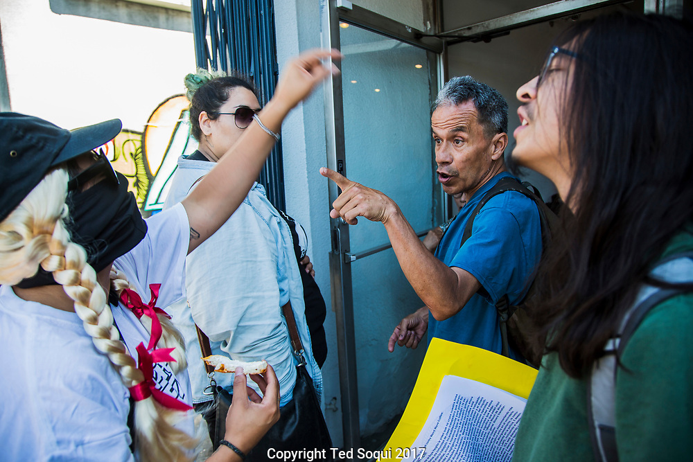 A male customer gets accosted by a demonstrated.<br /> Boycott and demonstration against Weird Wave Coffee House on Caesar E. Chavez Ave in Boyle Heights. About 25 demonstrators held signs and chanted slogans out front of the coffee house.
