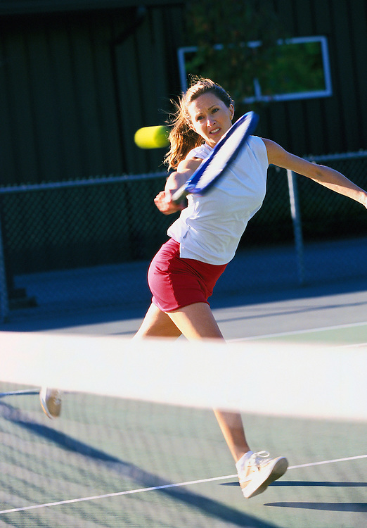 Young woman playing tennis&amp;#xA;<br />