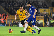 Wolverhampton Wanderers midfielder Romain Saiss (27) tracks Chelsea Midfielder Cesc Fabregas during the Premier League match between Wolverhampton Wanderers and Chelsea at Molineux, Wolverhampton, England on 5 December 2018.