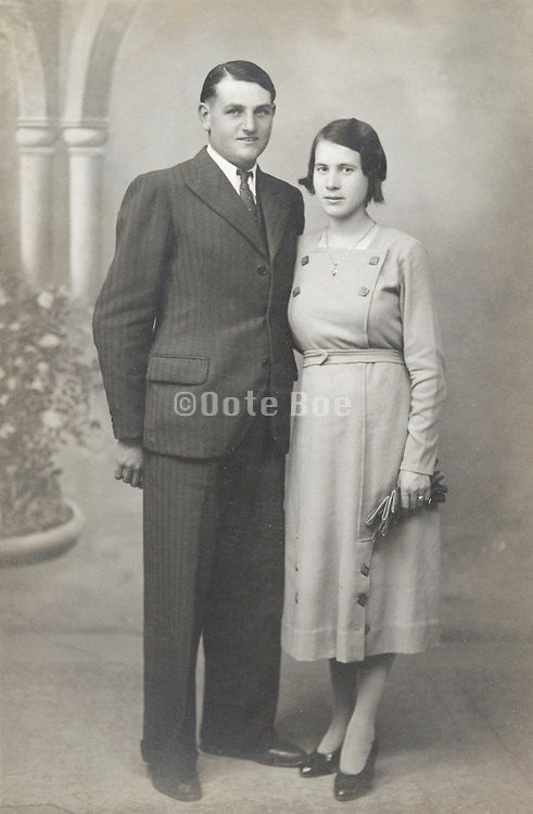 young adult couple posing in studio vintage photograph