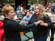 02 MARCH 2020 - ST. PAUL, MINNESOTA: Women dance in an aisle at a Bernie Sanders Get Out the Vote rally in the RiverCentre in St. Paul. More than 8,400 people attended the rally. Minnesota is a Super Tuesday state this year and Minnesotans will go to the polls Tuesday. Minnesota Sen. Amy Klobuchar was expected to win her home state, but she dropped out early Monday, March 2.        PHOTO BY JACK KURTZ