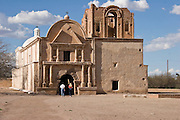 Tourists at the Spanish mission church in Tumacacori National Historical Park, Arizona